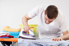 Man ironing clothes Royalty Free Stock Photo