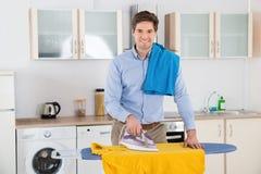 Man Ironing Clothes At Home Royalty Free Stock Photo