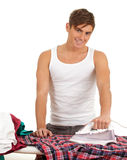 Man ironing clothes, housework Stock Photos