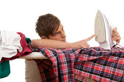 Man ironing clothes, housework Stock Image