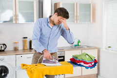 Man Ironing Clothes On Ironing Board Royalty Free Stock Images