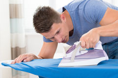Man Ironing Clothes Royalty Free Stock Images