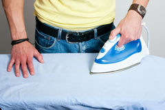 Man ironing a shirt Stock Photos