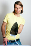 Man ironing a shirt Royalty Free Stock Photography