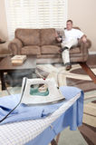 Man ironing shirt Royalty Free Stock Images