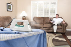 Man ironing shirt Stock Photo