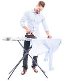 Man ironing shirt Stock Photography