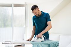 Man ironing shirt by iron at home Royalty Free Stock Photos