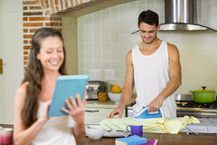 Man ironing a shirt in kitchen Stock Photography