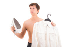 Man ironing shirt Royalty Free Stock Photo