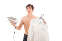 Man ironing shirt Stock Images