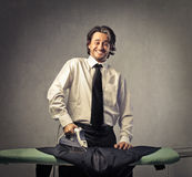 Man ironing suit Royalty Free Stock Photo