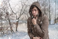 Free Man Is Freezing Outside In Cold Winter Stock Photo - 130134960