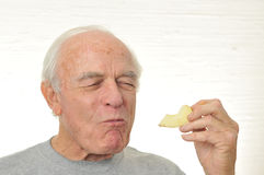 Man Is Happy Eating A Slice Of Apple Royalty Free Stock Images