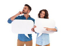 Man Is Thinking While Holding Speech Bubble Near Woman Pointing Royalty Free Stock Image