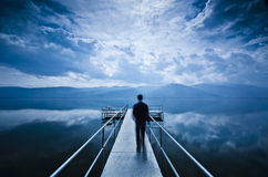 Free Man Is Walking On The Pier Stock Image - 56787211