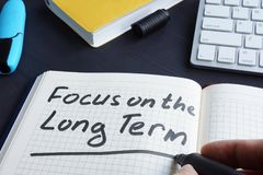 Free Man Is Writing Focus On The Long Term. Royalty Free Stock Images - 124552159