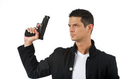Man isolated on white with a hand gun Royalty Free Stock Image