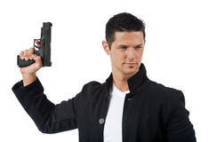Man isolated on white holding a hand gun Stock Photography