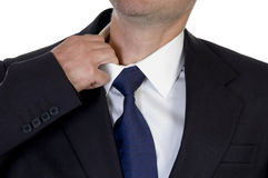 Man itching his neck with hand stock images