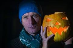 Man with Jack  lantern in the halloween night Stock Photos