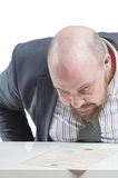 A man in a jacket carefully studying the document. In isolation. Royalty Free Stock Photos