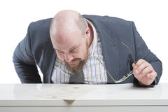A man in a jacket carefully studying the document. In isolation. Royalty Free Stock Photography
