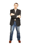 Man in a jacket and dark blue jeans Stock Photo