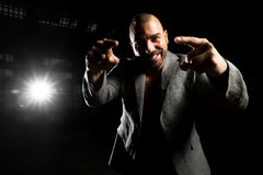 Man in a jacket in a dark room Stock Images