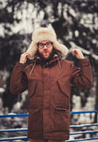 Man in jacket and fur winter hat Royalty Free Stock Images
