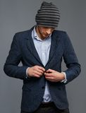 Man in jacket and hat Stock Photos