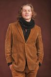Man in  jacket  isolated on brown background Royalty Free Stock Photography