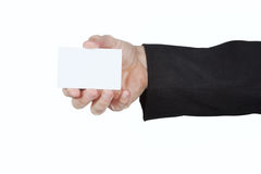 Man in the jacket keeps a blank card. Stock Images