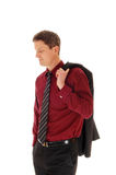 Man with jacket over shoulder. Royalty Free Stock Image