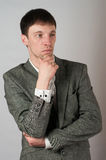 Man in jacket  pensive Royalty Free Stock Photography