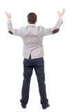 A man in a jacket raised his hands in prayer. Stock Photos