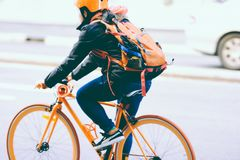Man in Jacket Riding Bicycle Stock Photo