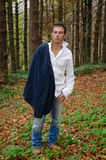 Man with jacket and shirt in the woods Royalty Free Stock Photography