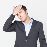 Man in jacket with strong headache Stock Photos