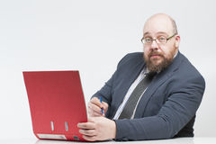 A man in a jacket to view documents in a folder. Royalty Free Stock Photos