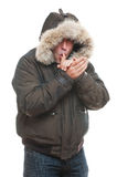 Man in jacket warming oneself. Isolated on white background Stock Photography