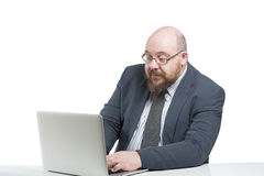 Man in a jacket works at the computer.  Royalty Free Stock Images