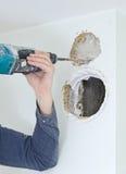 Man with jackhammer doing hole Stock Photos