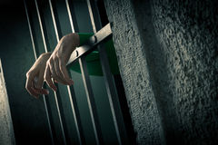Man in jail hands close-up Stock Photography