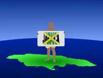 Man on Jamaica with sign Royalty Free Stock Photos