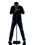 Man janitor brooming cleaner boredom silhouette Stock Photography