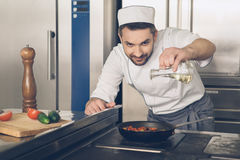 Man japanese restaurant chef cooking in the kitchen Stock Image