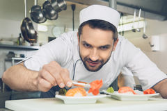 Man japanese restaurant chef cooking in the kitchen Stock Photography