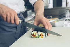 Man japanese restaurant chef cooking in the kitchen Royalty Free Stock Image