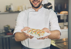 Man japanese restaurant chef cooking in the kitchen Royalty Free Stock Photos